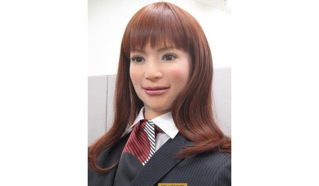 A close-up of an actroid robot, modeled after a young Japanese woman.