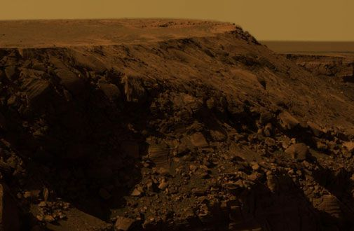 On the edge of a Martian crater.