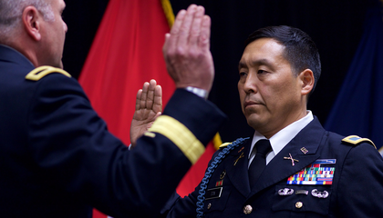Alaska Army National Guard Col. Wayne Don, then 38th Troop Command commander, pledges the Oath of Office, administered by Alaska Army National Guard Brig. Gen. Joseph Streff, Alaska Army National Guard commander, after Don was promoted to full colonel. Dena'ina Center, Anchorage, July 14, 2017.  (U.S. Army photo by Sgt. David Bedard)