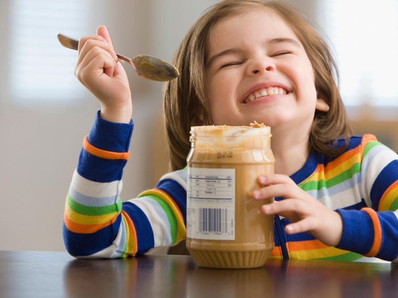 Kid Eating Peanut Butter