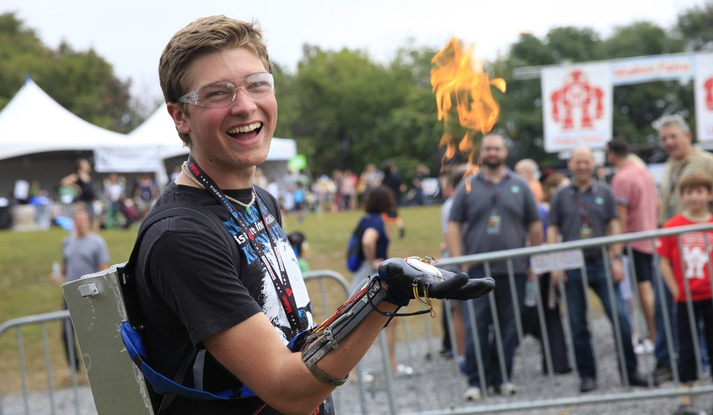 Stephen Hawes, an engineering student at the University of Connecticut, demonstrates his forearm-mounted flamethrower at the World Maker Faire 2014.