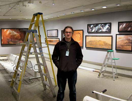 Author Michael Benson helps to set up the new National Air and Space Museum exhibition