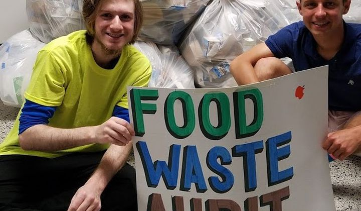 Garreth Bartholomew and Matthew Capuano-Rizzo from Eco-Teen Action Network pose with the recyclable portion of their school-wide waste audit on April 27, 2019.