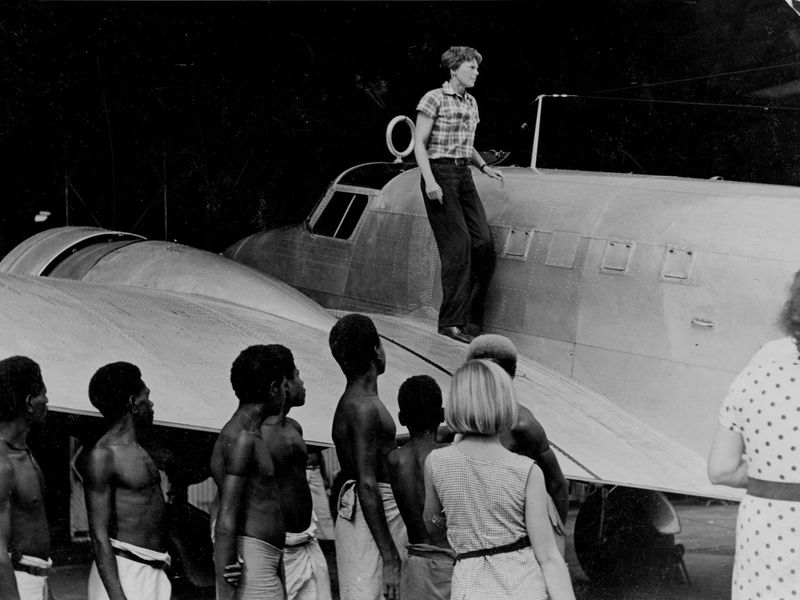 Amelia Earhart on the wing of her plane