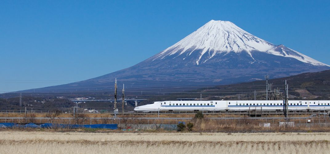 Japan's bullet train with Mt. Fuji in the distance