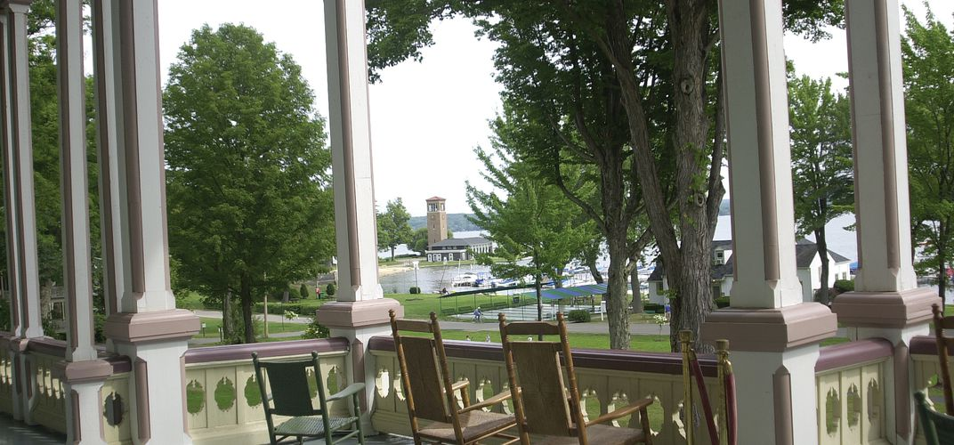Relax on the porch at the historic Hotel Athenaeum