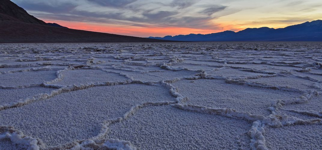 Badwater Basin salt flats at sunset. Credit: Brandon Yoshizawa