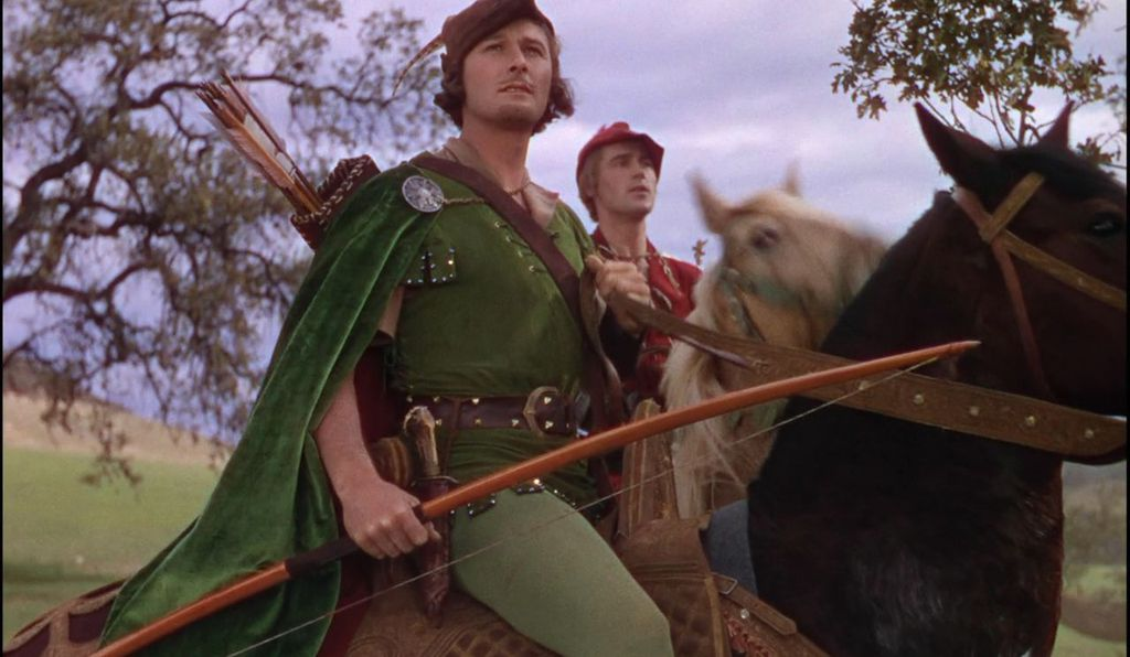 Errol Flynn, with sword and longbow, played Robin  during the Great Depression in the 1938 <em>The Adventures of Robin Hood,</em> a Technicolor extravaganza that codified Robin as leader of a jolly band of bandits in Sherwood Forest, fighting passionately for truth and justice against unscrupulous noblemen.