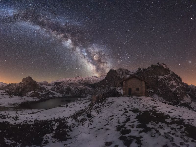 This photo shows a panoramic view from the viewpoint of the Covadonga Lakes in the National Park of the Picos de Europa in Asturias (Spain). On the left side we see the lake Ercina surrounded by the lactea, in the left Lake Enol and in the center a cabin for shepherds who use during the summer when they raise the cattle to graze to this place.