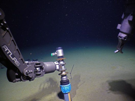 View from deep sea research vessel of sediment coring device on the bottom of the Arctic Ocean