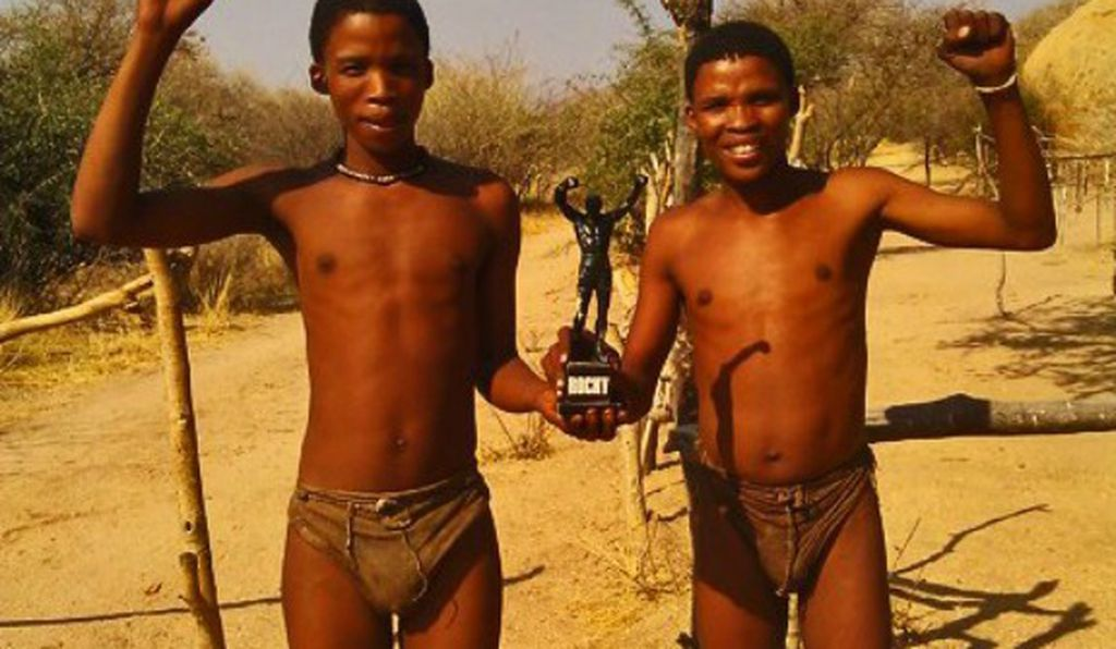 During the Milnes' visit to Namibia, they posed Little Rocky for this photo with two boys of the San people—the culture featured in the film The Gods Must Be Crazy.