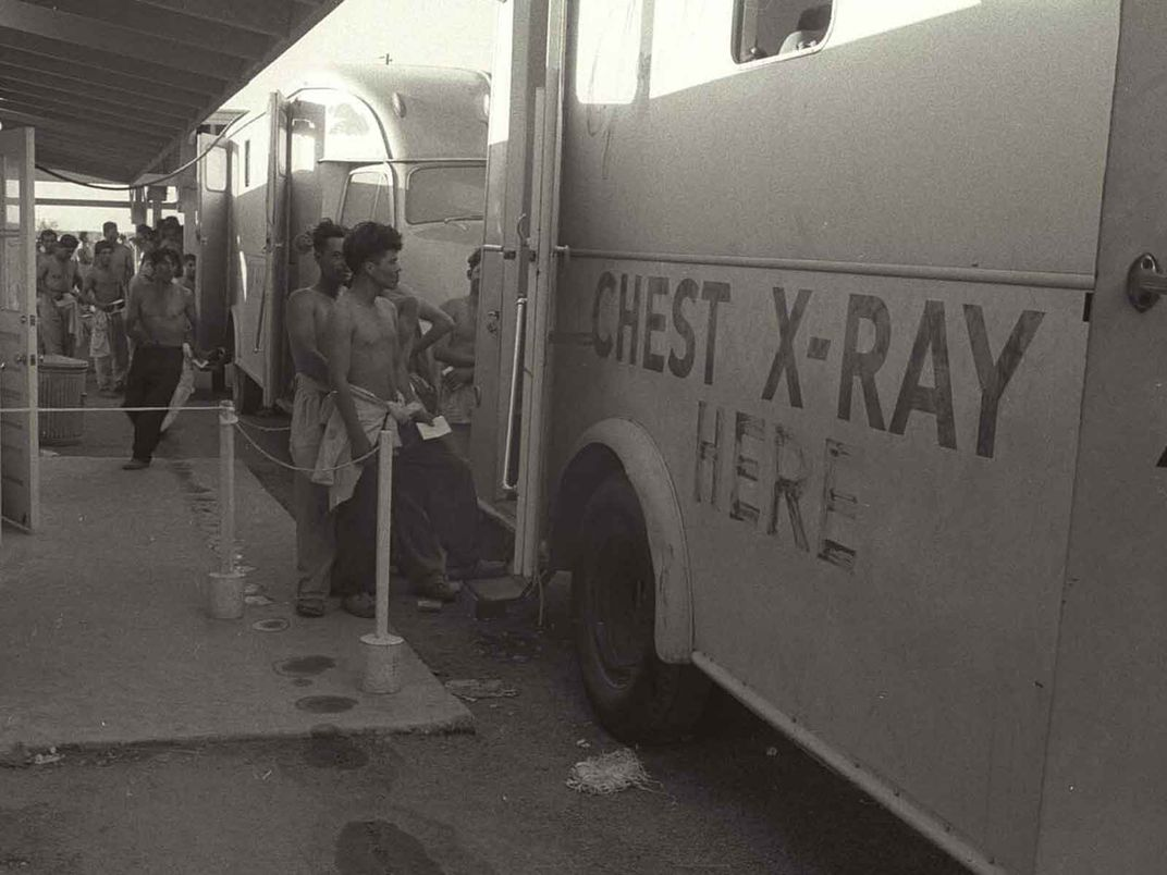 Braceros approach a chest x-ray truck to get examined