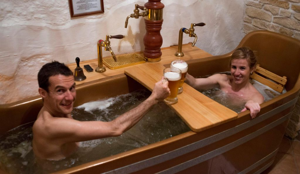 A couple enjoys the Bernard Beer Spa in Prague.