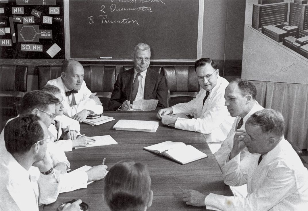 "Cornelius ""Dusty"" Rhoads, center, former medical chief of the Chemical Warfare Service and director of the Sloan Kettering Institute for Cancer Research."