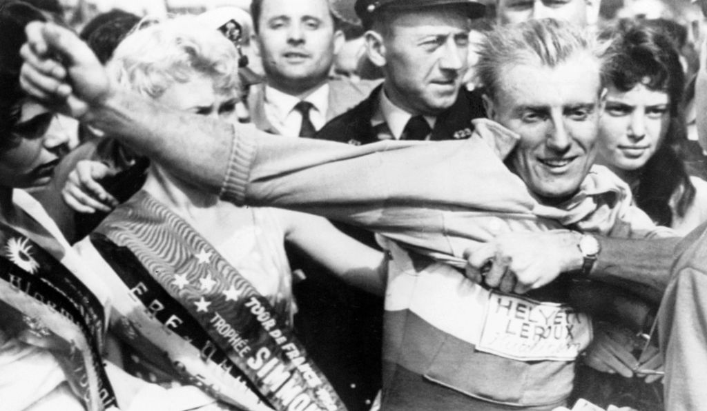 Frenchman Andre Darrigade puts on the yellow jersey, 1958.