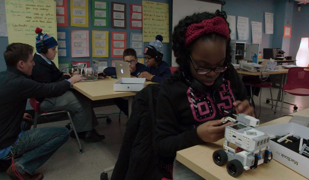 The NYPL hosts after-school education programs across the city. Here, students work on a robotics project designed to introduce them to computer coding.