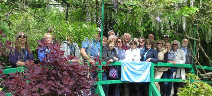 Smithsonian Journeys Travelers enjoying their time visiting Claude Monet's garden at Giverny