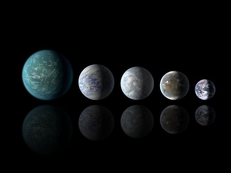Artists illustrations of the previously known Kepler 22b, and the new 69c, 62e and 62f line up next to Earth.