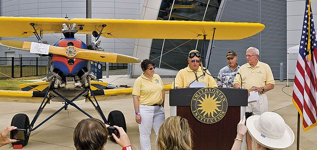 An emotional Gene Breiner (at lectern, with daughter Joyce and General Jack Dailey, director of the National Air and Space Museum) donated Plane Jane to the Museum this past June in hopes of inspiring future pilots.