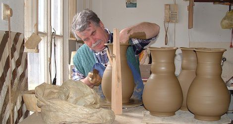 A professional potter works on his craft in Mezőtúr, Hungary, a town known for its traditional pottery-making.