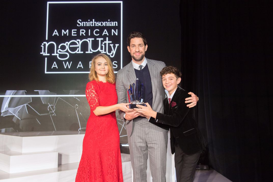 <em>A Quiet Place</em> actors Millicent Simmonds (left) and Noah Jupe (right) with their co-star and director, John Krasinski