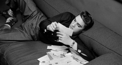 Elvis at 21: Presley reads fan mail on March 17, 1956