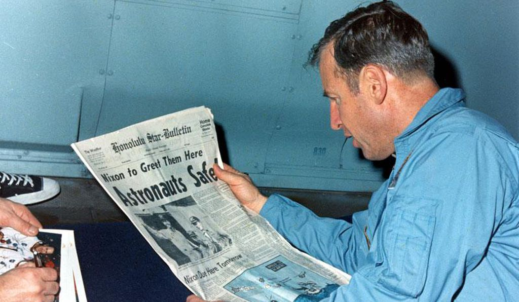 Jim Lovell reads a newspaper account of the Apollo 13 recovery.