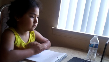 A Diné child begins her much-anticipated school year online in Albuquerque, New Mexico. (Courtesy of Cornillia Sandoval, used with permission)