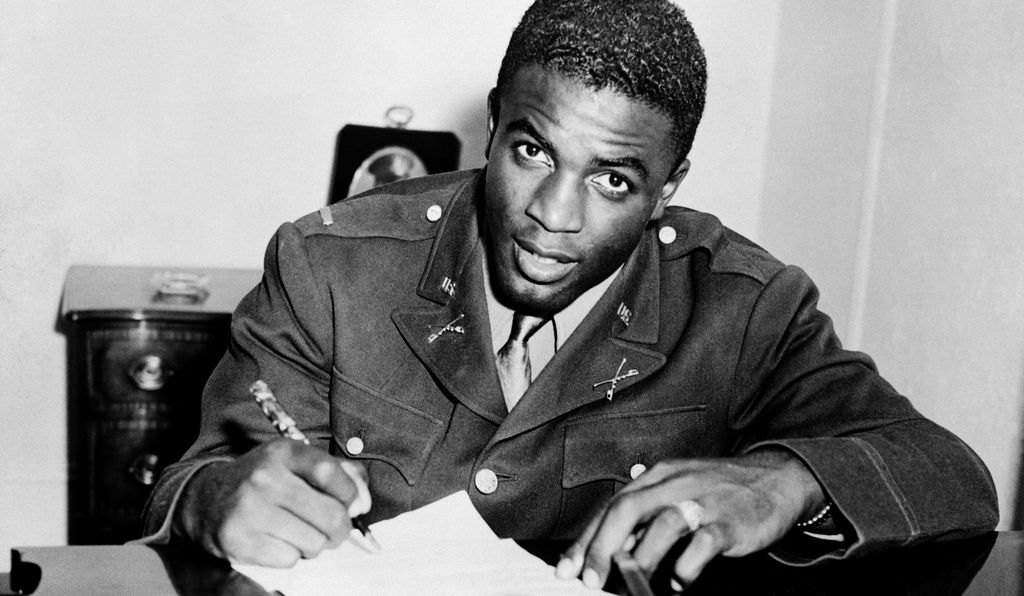 Jackie Robinson, in military uniform, becomes the first African American to sign with a white professional baseball team. He signs a contract with the minor league club in Montreal, a farm team for the Brooklyn Dodgers.