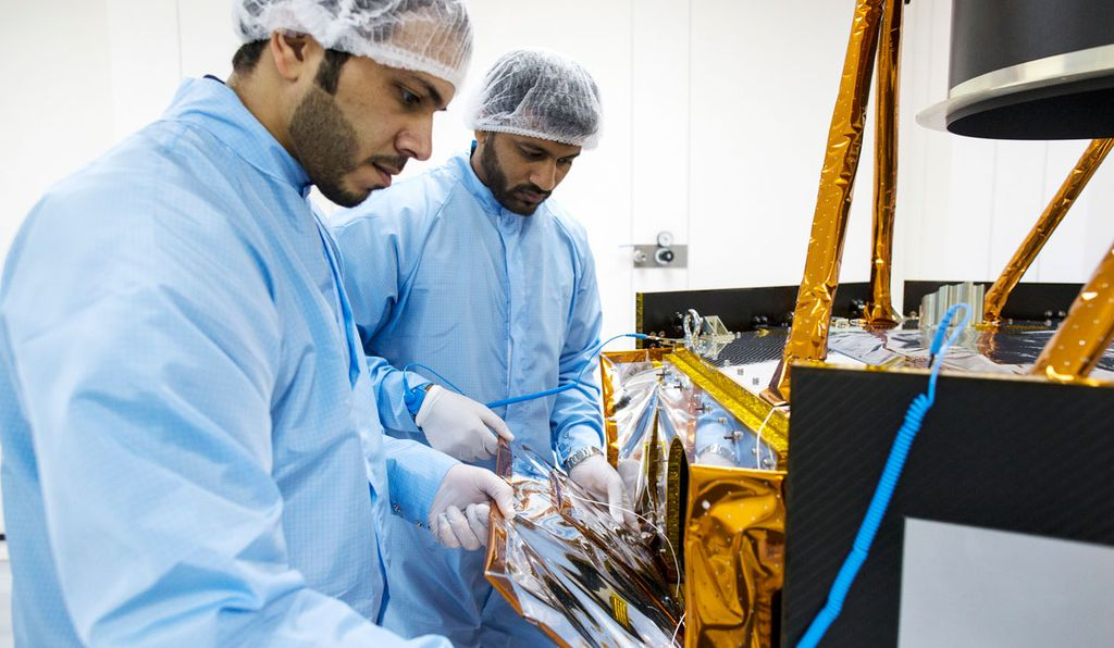 Engineers disassemble multi-layer insulation to inspect the the Hope probe's instruments.