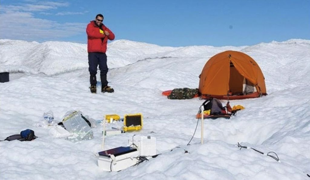 Alex Anesio and his team sleep in tents on the ice during their field studies. Some of the ice below the tent melts, but the tent then behaves as an insulator and keeps most of the base frozen, Anesio says.