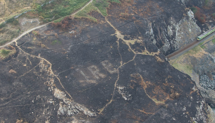 Scorched Earth from Ireland Fire Illuminates WWII-Era Sign