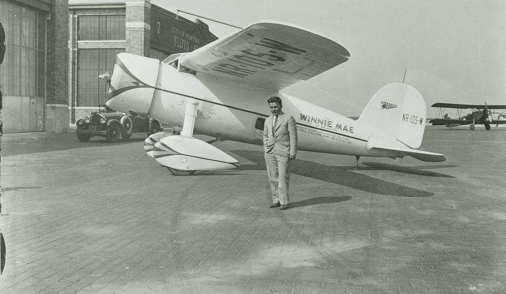 Aviator Wiley Post under the wing of the Winnie Mae (1933).