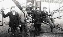John, Joe, George, and Matt Savidge (from left) with one of their biplanes, ca. 1912.