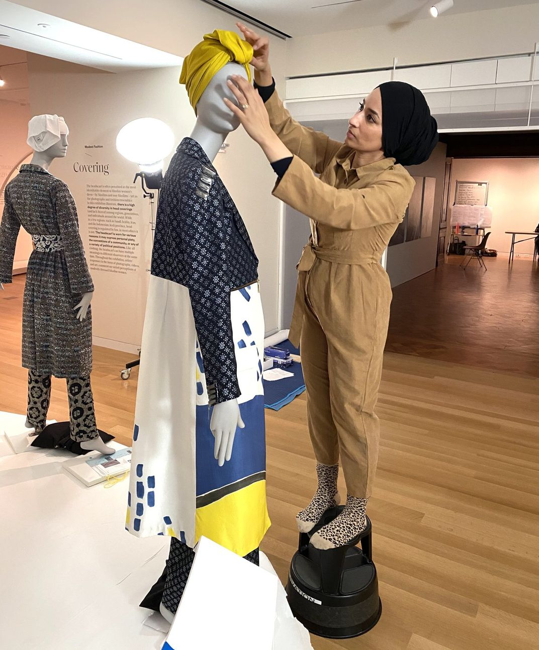 Saba Ali styles a mannequin in the Contemporary Muslim Fashions exhibition