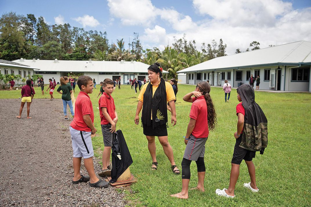 Pele chats in Hawaiian with her students