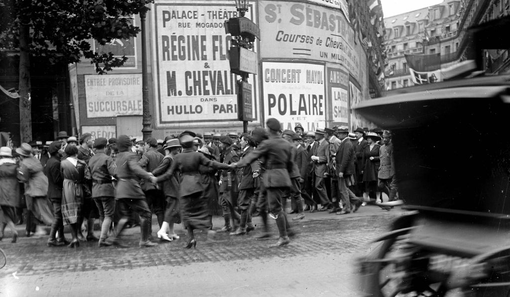 Parisians start a round dance in the streets to celebrate the signing of the treaty, June 28, 1919.
