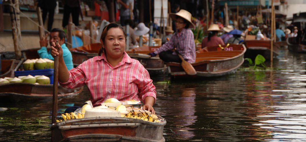 Rural floating market, reflecting traditional river life, Amphawa