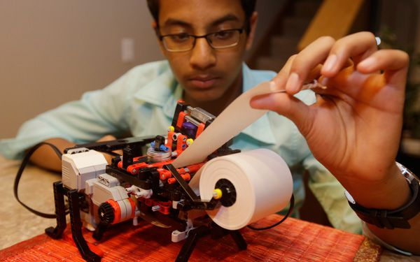 Teen uses Legos to build braille printer