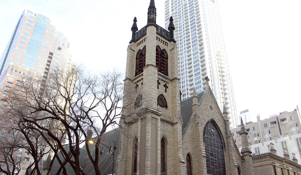 The bell tower of the St. James Cathedral retains its char marks from the Chicago Fire.