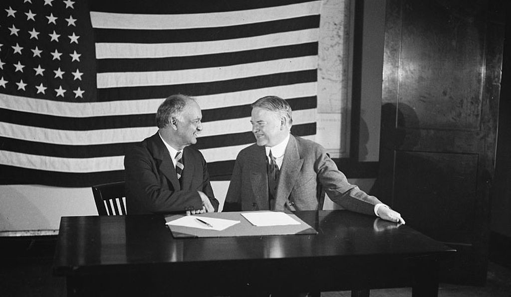 Charles Curtis (left) sits with Herbert Hoover.