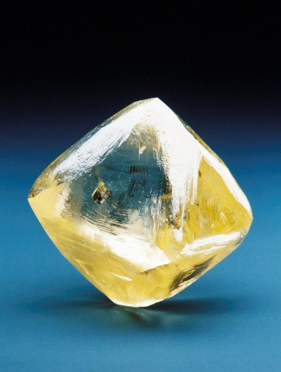 A pale yellow diamond on a teal background.