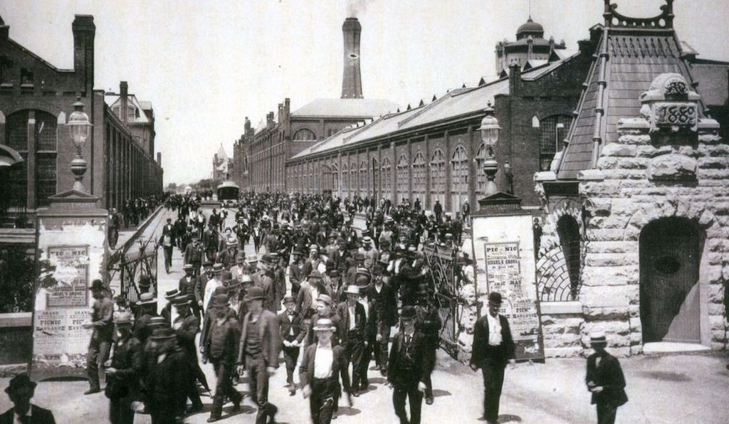Workers leave the Pullman Car Company factory in 1893, one year before they joined a national railroad strike.