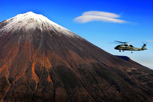 A U.S. Army Sikorsky helicopter backdropped by Japan's famous landmark.