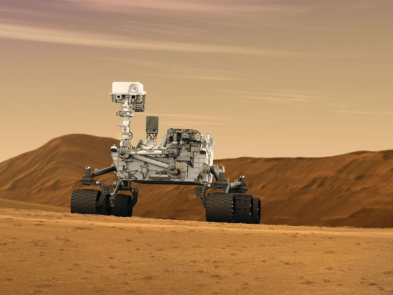 1280px-Mars_Rover_Curiosity_in_Artist's_Concept,_Wide.jpg