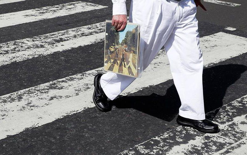 Crossing street with Abbey Road album.jpg