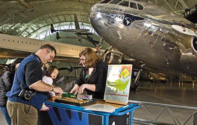 Katherine Peterson teaches visitors about airport codes.