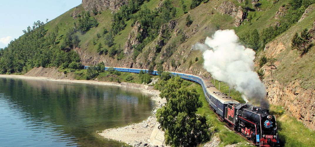 The <i>Golden Eagle Trans-Siberian Express</i>, traveling along Lake Baikal
