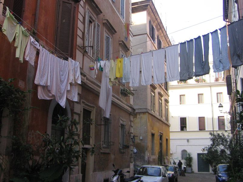 Laundry is hung to dry above an Italian street