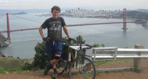 The author and his bike stand about 850 feet above San Francisco on Conzelman Road. Repeated 10 times, this little hill amounts to a world classic of climbing.